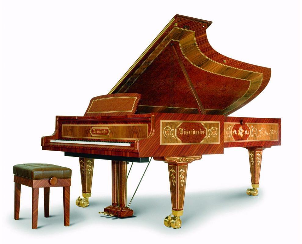 Imagen piano de cola BÖSENDORFER modelo especial Artisan madera amboyna decorado floral