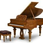 Imagen piano de cola BÖSENDORFER modelo especial Strauss con banqueta cerezo satinado