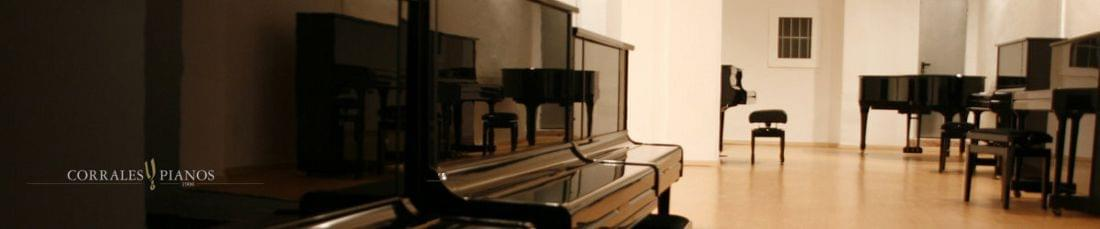Imagen del almacén de pianos verticales